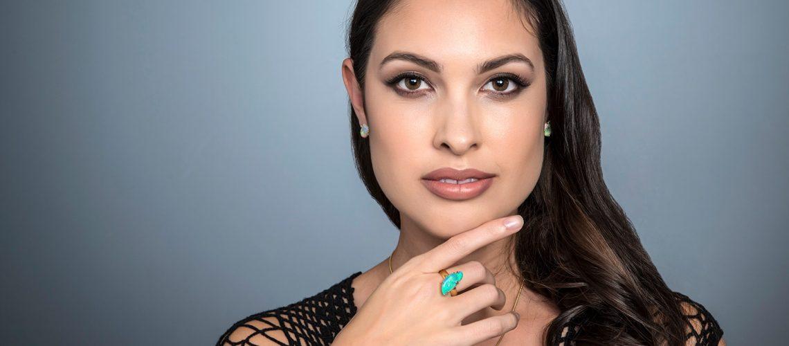 model wearing opal jewellery